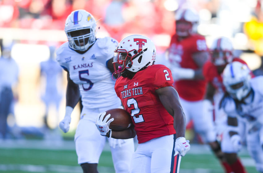 LUBBOCK, TX - OCTOBER 20: Demarcus Felton #2 of the Texas Tech Red Raiders runs past Azur Kamara #5 of the Kansas Jayhawks and will score a touchdown during the second half of the game on October 20, 2018 at Jones AT&T Stadium in Lubbock, Texas. Texas Tech defeated Kansas 48-16. (Photo by John Weast/Getty Images)