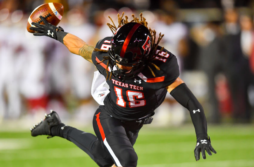 LUBBOCK, TX - NOVEMBER 03: Thomas Leggett #16 of the Texas Tech Red Raiders knocks the ball back into the field of play downing the ball on the one yard line during the first half of the game against the Oklahoma Sooners on November 3, 2018 at Jones AT&T Stadium in Lubbock, Texas. (Photo by John Weast/Getty Images)