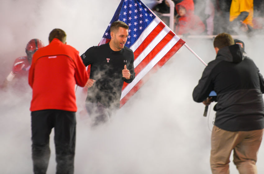 LUBBOCK, TX - NOVEMBER 10: Head coach Kliff Kingsbury of the Texas Tech Red Raiders leads his team onto the field before the game against the Texas Longhorns on November 10, 2018 at Jones AT&T Stadium in Lubbock, Texas. Texas defeated Texas Tech 41-34. (Photo by John Weast/Getty Images)