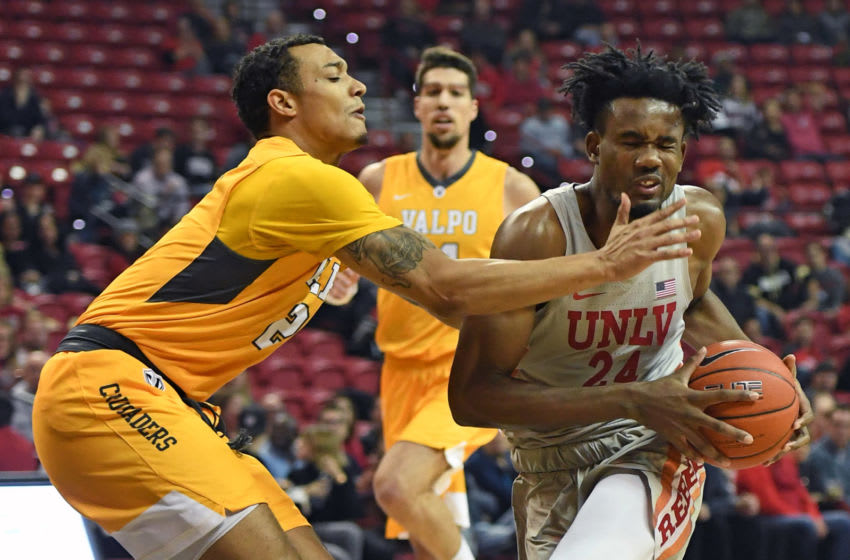 LAS VEGAS, NEVADA - NOVEMBER 28: Joel Ntambwe #24 of the UNLV Rebels is fouled as he drives against Deion Lavender #2 of the Valparaiso Crusaders during their game at the Thomas & Mack Center on November 28, 2018 in Las Vegas, Nevada. The Crusaders defeated the Rebels 72-64. (Photo by Ethan Miller/Getty Images)