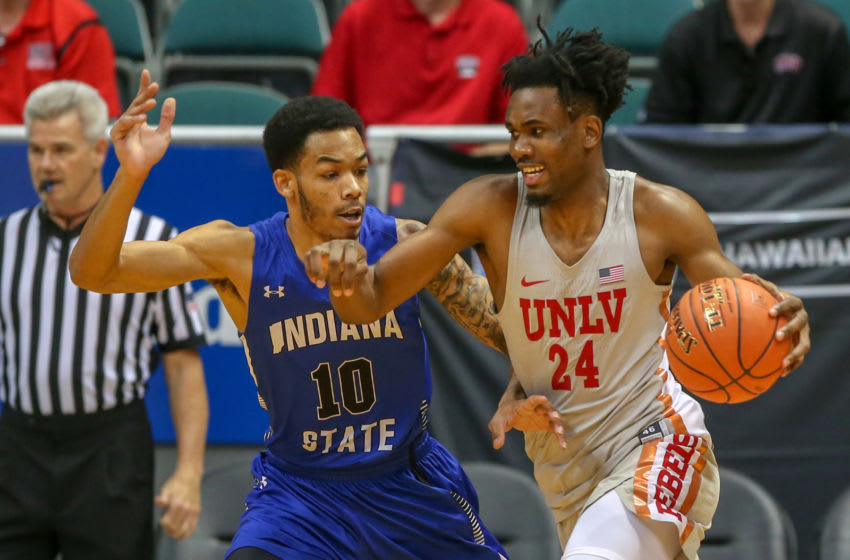 HONOLULU, HI - DECEMBER 23: Joel Ntambwe #24 of the UNLV Runnin' Rebels attempts to drive past Christian Williams #10 of the Indiana State Sycamores during the first half of their game at Stan Sheriff Center on December 23, 2018 in Honolulu, Hawaii. (Photo by Darryl Oumi/Getty Images)