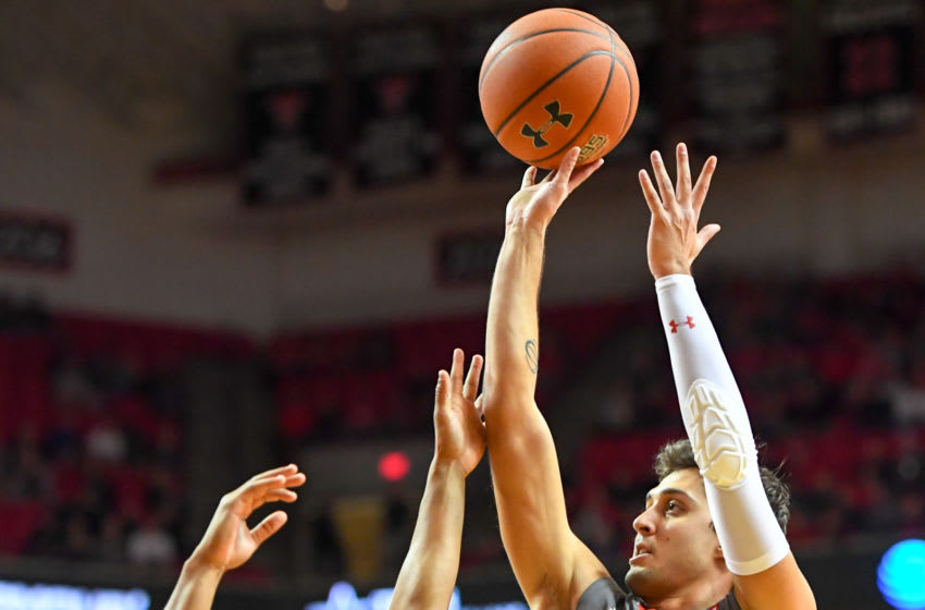 LUBBOCK, TX - JANUARY 05: Davide Moretti #25 of the Texas Tech Red Raiders shoots the ball during the first half of the game against the Kansas State Wildcats on January 5, 2019 at United Supermarkets Arena in Lubbock, Texas. (Photo by John Weast/Getty Images)