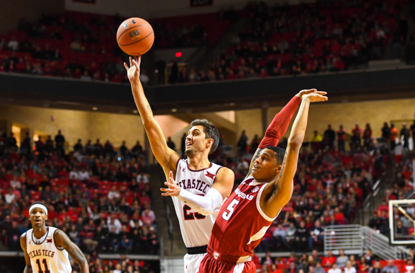 LUBBOCK, TX - JANUARY 26: Davide Moretti #25 of the Texas Tech Red Raiders shoots the ball over Jalen Harris #5 of the Arkansas Razorbacks during the first half of the game on January 26, 2019 at United Supermarkets Arena in Lubbock, Texas. (Photo by John Weast/Getty Images)