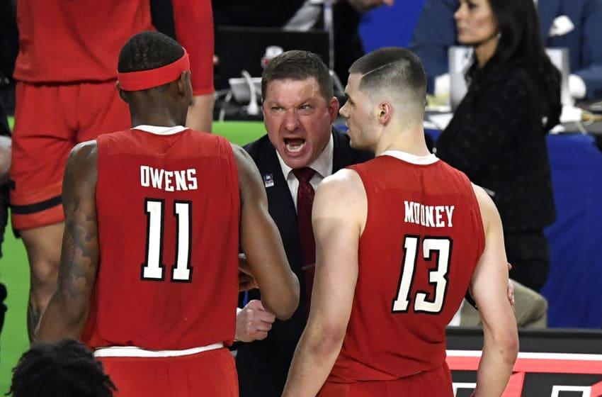 MINNEAPOLIS, MINNESOTA - APRIL 06: Head coach Chris Beard of the Texas Tech Red Raiders reacts with Tariq Owens #11 and Matt Mooney #13 in the first half against the Michigan State Spartans during the 2019 NCAA Final Four semifinal at U.S. Bank Stadium on April 6, 2019 in Minneapolis, Minnesota. (Photo by Hannah Foslien/Getty Images)