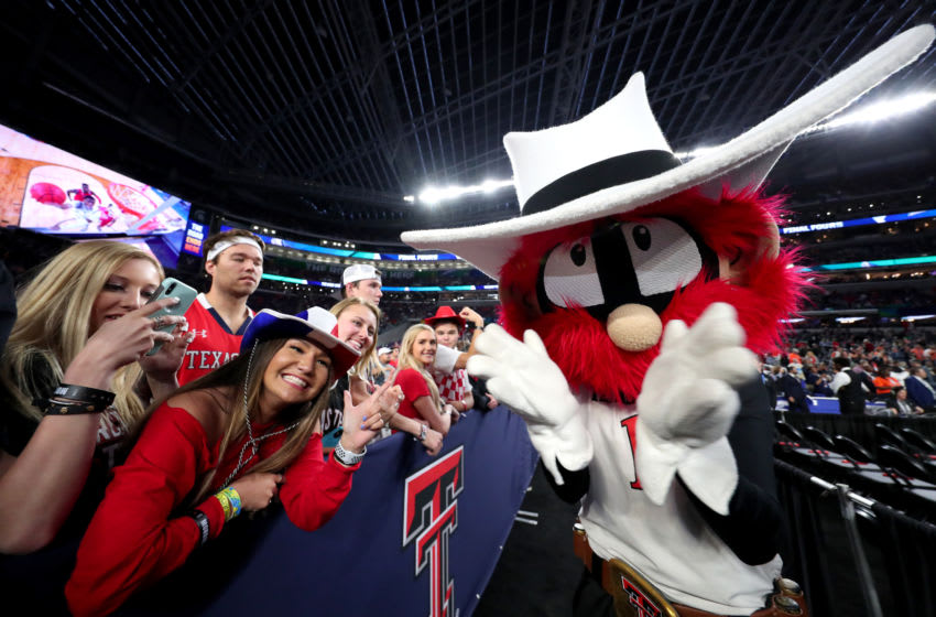 MINNEAPOLIS, MINNESOTA - APRIL 08: The Texas Tech Red Raiders mascot poses for a photo with fans prior to the 2019 NCAA men's Final Four National Championship game between the Virginia Cavaliers and the Texas Tech Red Raiders at U.S. Bank Stadium on April 08, 2019 in Minneapolis, Minnesota. (Photo by Tom Pennington/Getty Images)