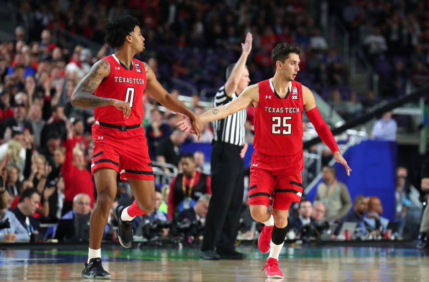 MINNEAPOLIS, MINNESOTA - APRIL 08: Kyler Edwards #0 and Davide Moretti #25 of the Texas Tech Red Raiders react against the Virginia Cavaliers in the first half during the 2019 NCAA men's Final Four National Championship game at U.S. Bank Stadium on April 08, 2019 in Minneapolis, Minnesota. (Photo by Tom Pennington/Getty Images)