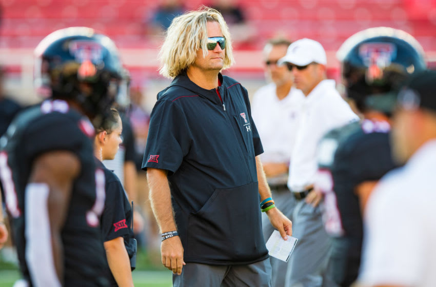 LUBBOCK, TEXAS - SEPTEMBER 07: Offensive Coordinator David Yost of Texas Tech watches pregame warmups before the college football game between the Texas Tech Red Raiders and the UTEP Miners on September 07, 2019 at Jones AT&T Stadium in Lubbock, Texas. (Photo by John E. Moore III/Getty Images)
