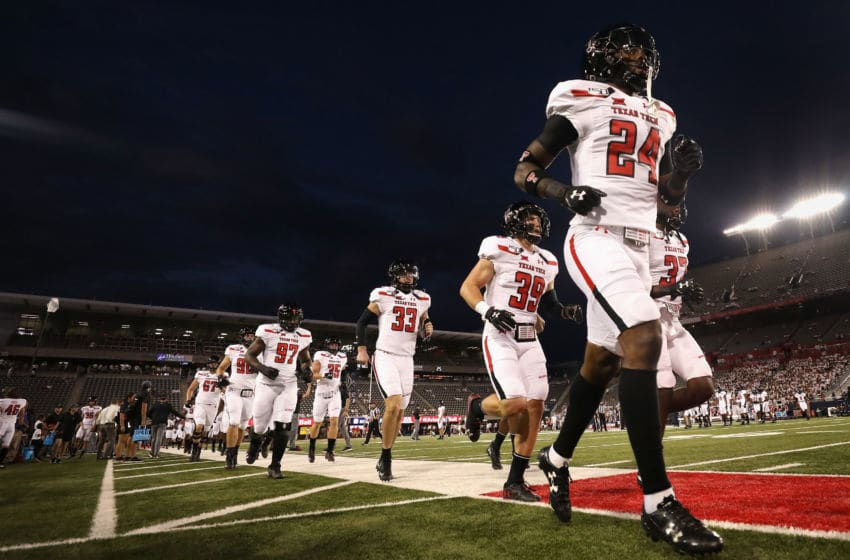 TUCSON, ARIZONA - SEPTEMBER 14: Defensive back Adam Beck #24 of the Texas Tech Red Raiders leads teammates onto the field before the start of the NCAAF game against the Arizona Wildcats at Arizona Stadium on September 14, 2019 in Tucson, Arizona. (Photo by Christian Petersen/Getty Images)
