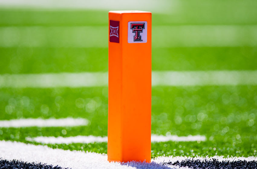 LUBBOCK, TEXAS - OCTOBER 05: An end zone pylon bearing the logos of the Texas Tech Red Raiders and the Big 12 Conference is pitcured during the second half of the college football game against the Oklahoma State Cowboys on October 05, 2019 at Jones AT&T Stadium in Lubbock, Texas. (Photo by John E. Moore III/Getty Images)