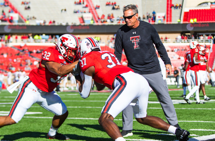LUBBOCK, TEXAS - OCTOBER 19: Defensive coordinator Keith Patterson of the Texas Tech Red Raiders oversees warmups as linebackers Tyrique Matthews #32 and Xavier Benson #37 warm up before the college football game against the Iowa State Cyclones on October 19, 2019 at Jones AT&T Stadium in Lubbock, Texas. (Photo by John E. Moore III/Getty Images)