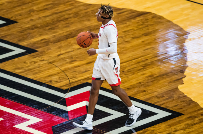 LUBBOCK, TEXAS - NOVEMBER 05: Guard Jahmi'us Ramsey #3 of the Texas Tech Red Raiders handles the ball during the second half of the college basketball game against the Eastern Illinois Panthers at United Supermarkets Arena on November 05, 2019 in Lubbock, Texas. (Photo by John E. Moore III/Getty Images)