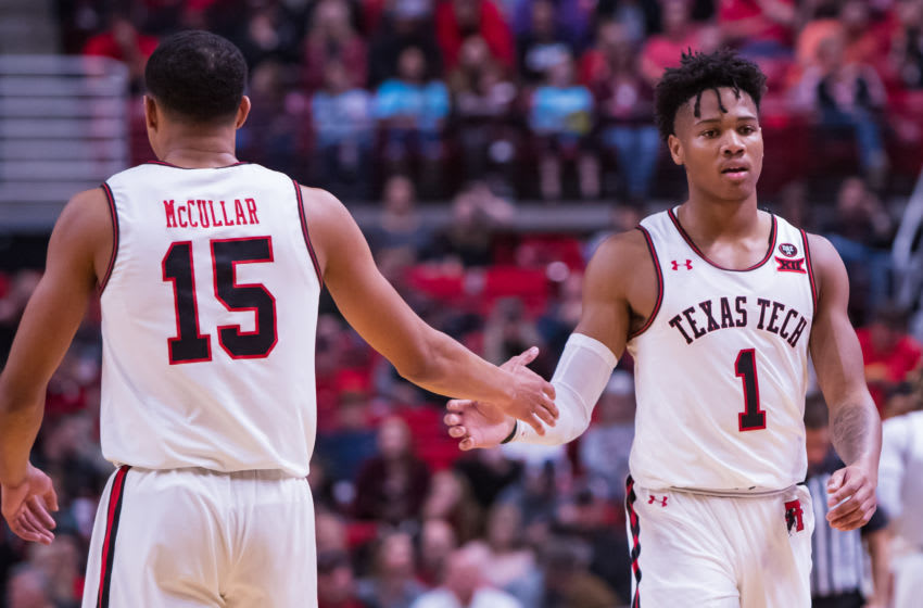 LUBBOCK, TEXAS - NOVEMBER 21: Guards Kevin McCullar #15 and Terrence Shannon #1 of the Texas Tech Red Raiders high five each other during the first half of the college basketball game against the Tennessee State Tigers on November 21, 2019 at United Supermarkets Arena in Lubbock, Texas. (Photo by John E. Moore III/Getty Images)