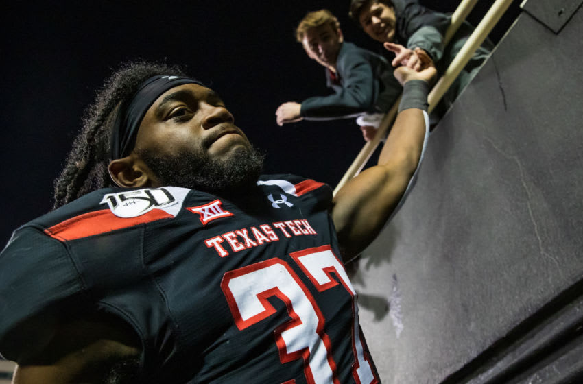 LUBBOCK, TEXAS - NOVEMBER 23: Linebacker Xavier Benson #37 of the Texas Tech Red Raiders high fives fans after the college football game against the Kansas State Wildcats on November 23, 2019 at Jones AT&T Stadium in Lubbock, Texas. (Photo by John E. Moore III/Getty Images)