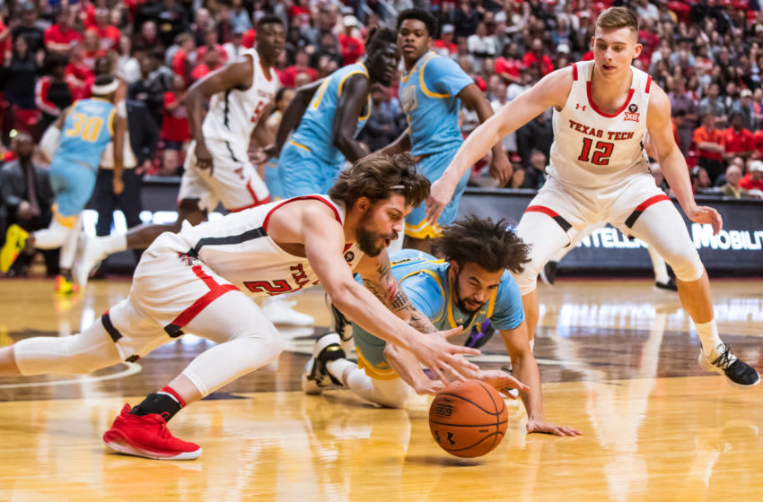 LUBBOCK, TEXAS - NOVEMBER 24: Guard Avery Benson #24 of the Texas Tech Red Raiders dives for a loose ball against guard Julian Batts #1 of the LIU Sharks during the second half of the college basketball game on November 24, 2019 at United Supermarkets Arena in Lubbock, Texas. (Photo by John E. Moore III/Getty Images)