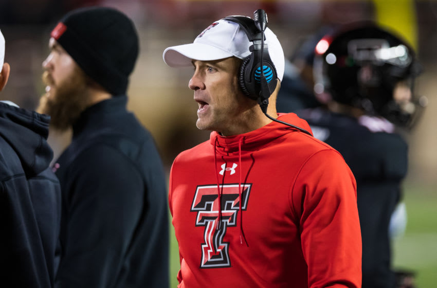 LUBBOCK, TEXAS - NOVEMBER 23: Head coach Matt Wells of the Texas Tech Red Raiders looks on during a timeout huddle during the second half of the college football game against the Kansas State Wildcats on November 23, 2019 at Jones AT&T Stadium in Lubbock, Texas. (Photo by John E. Moore III/Getty Images)