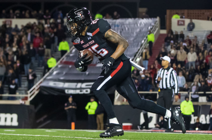 LUBBOCK, TEXAS - NOVEMBER 23: Kick returner Dadrion Taylor #25 of the Texas Tech Red Raiders returns a kick off during the second half of the college football game against the Kansas State Wildcats on November 23, 2019 at Jones AT&T Stadium in Lubbock, Texas. (Photo by John E. Moore III/Getty Images)