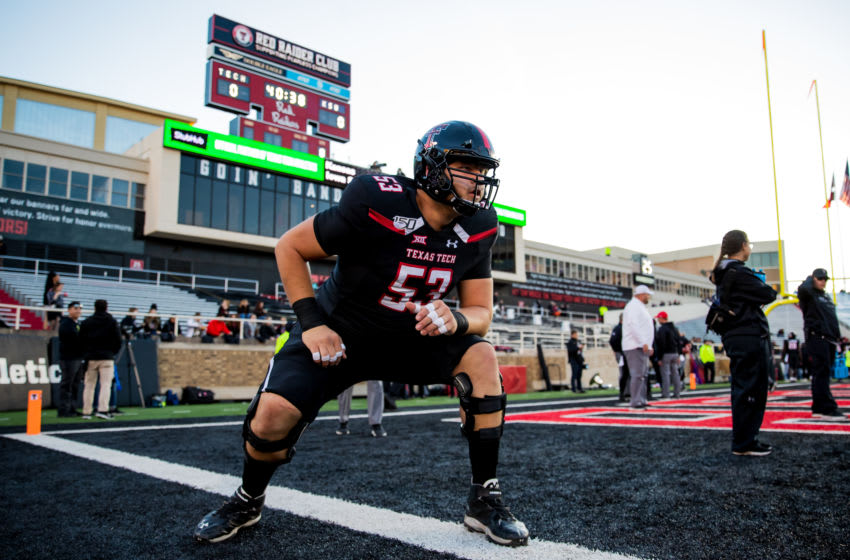 LUBBOCK, TEXAS - NOVEMBER 23: Offensive lineman Trevor Roberson #53 of the Texas Tech Red Raiders warms up before the college football game against the Kansas State Wildcats on November 23, 2019 at Jones AT&T Stadium in Lubbock, Texas. (Photo by John E. Moore III/Getty Images)