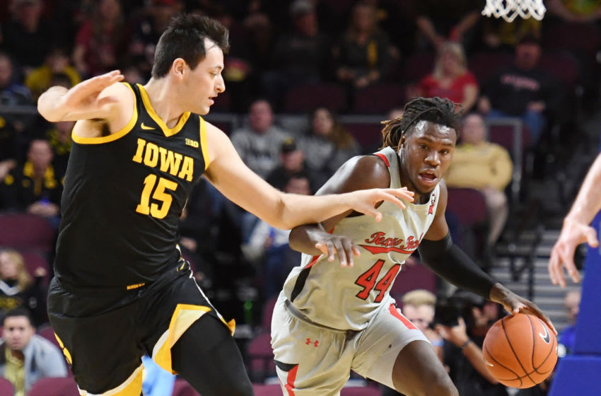 LAS VEGAS, NEVADA - NOVEMBER 28: Chris Clarke #44 of the Texas Tech Red Raiders drives against Ryan Kriener #15 of the Iowa Hawkeyes during the 2019 Continental Tire Las Vegas Invitational basketball tournament at the Orleans Arena on November 28, 2019 in Las Vegas, Nevada. (Photo by Ethan Miller/Getty Images)
