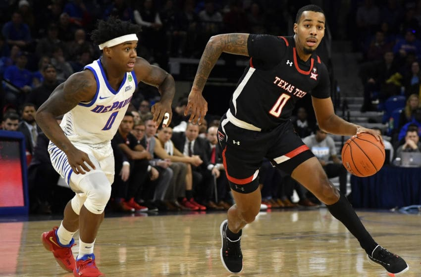 CHICAGO, ILLINOIS - DECEMBER 04: Kyler Edwards #0 of the Texas Tech Red Raiders drives with the basketball in the first half against Markese Jacobs #0 of the DePaul Blue Demons at Wintrust Arena on December 04, 2019 in Chicago, Illinois. (Photo by Quinn Harris/Getty Images)