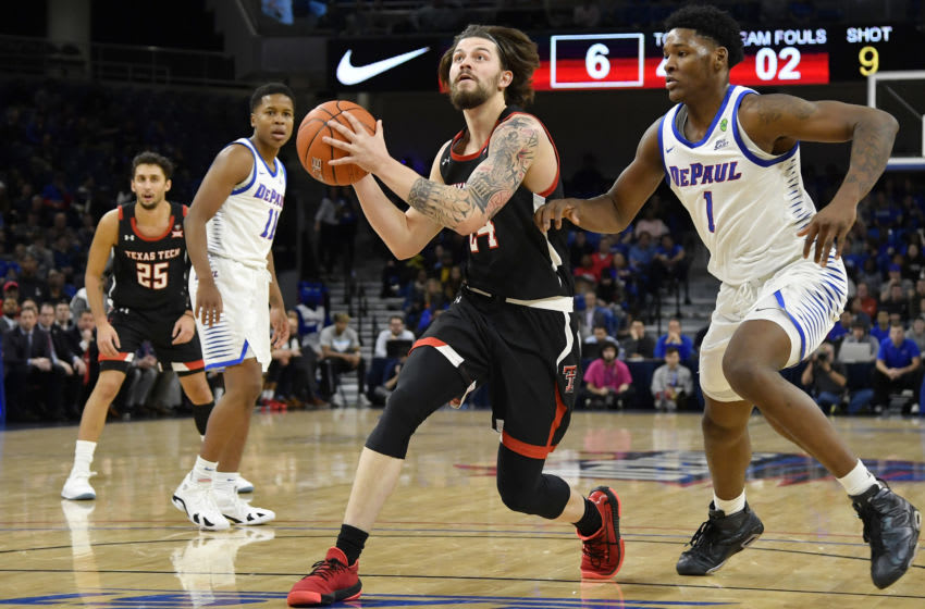 CHICAGO, ILLINOIS - DECEMBER 04: Avery Benson #24 of the Texas Tech Red Raiders drives with the basketball Romeo Weems #1 of the DePaul Blue Demons at Wintrust Arena on December 04, 2019 in Chicago, Illinois. (Photo by Quinn Harris/Getty Images)