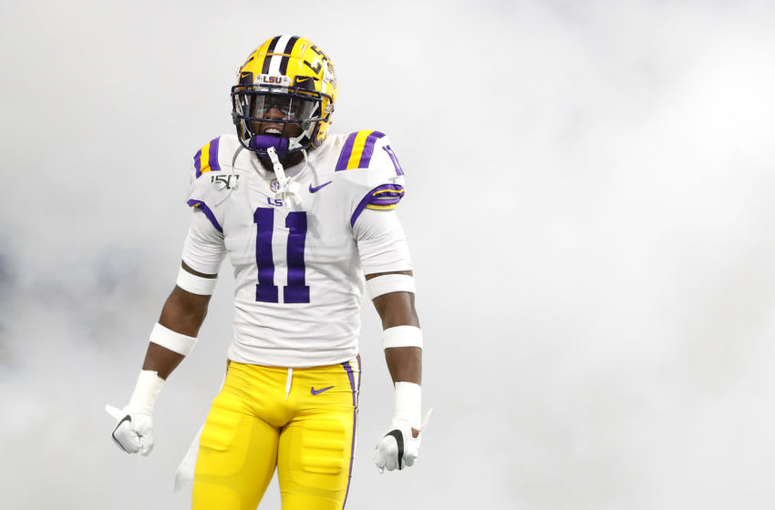 ATLANTA, GEORGIA - DECEMBER 07: Eric Monroe #11 of the LSU Tigers reacts as he takes the field before the SEC Championship game against the Georgia Bulldogs at Mercedes-Benz Stadium on December 07, 2019 in Atlanta, Georgia. (Photo by Kevin C. Cox/Getty Images)