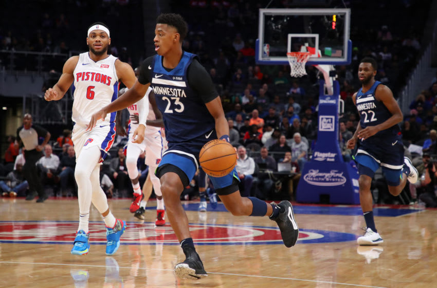 DETROIT, MICHIGAN - NOVEMBER 11: Jarrett Culver #23 of the Minnesota Timberwolves drives to the basket in front of Bruce Brown #6 of the Detroit Pistons during the first half at Little Caesars Arena on November 11, 2019 in Detroit, Michigan. NOTE TO USER: User expressly acknowledges and agrees that, by downloading and or using this photograph, User is consenting to the terms and conditions of the Getty Images License Agreement. (Photo by Gregory Shamus/Getty Images)