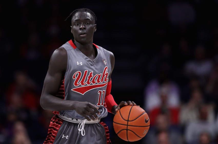 TUCSON, ARIZONA - JANUARY 16: Both Gach #11 of the Utah Utes handles the ball during the second half of the NCAAB game against the Arizona Wildcats at McKale Center on January 16, 2020 in Tucson, Arizona. (Photo by Christian Petersen/Getty Images)