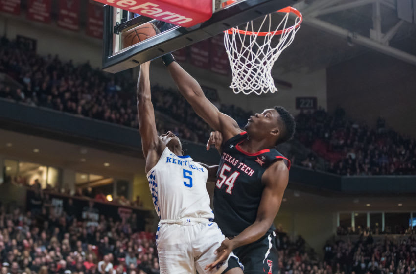 LUBBOCK, TEXAS - JANUARY 25: Center Russel Tchewa #54 of the Texas Tech Red Raiders blocks a shot attempt by guard Immanuel Quickley #5 of the Kentucky Wildcats during the first half of the college basketball game at United Supermarkets Arena on January 25, 2020 in Lubbock, Texas. (Photo by John E. Moore III/Getty Images)