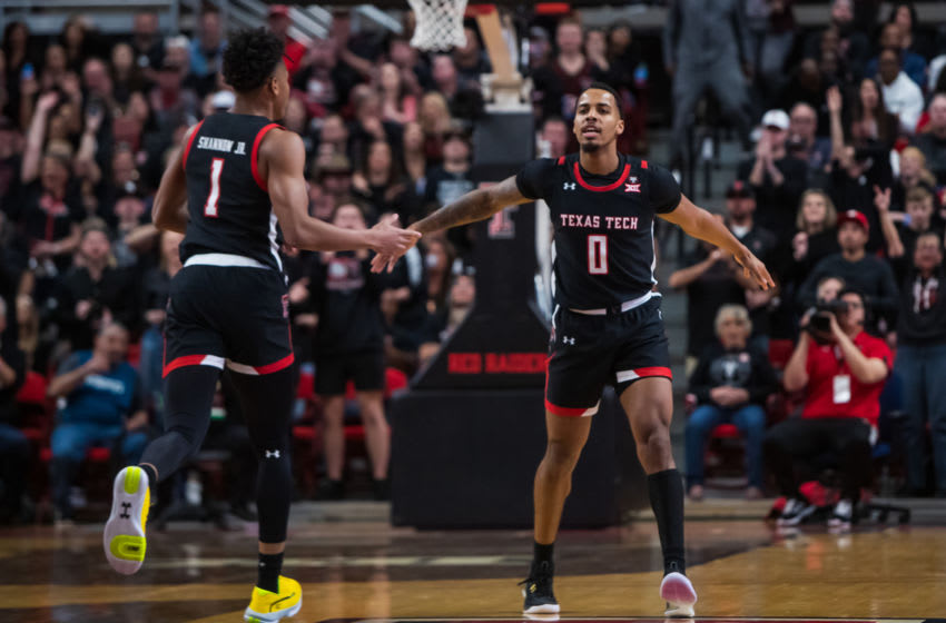 LUBBOCK, TEXAS - JANUARY 25: Guard Kyler Edwards #0 of the Texas Tech Red Raiders high fives guard Terrence Shannon Jr. #1 during the first half of the college basketball game against the Kentucky Wildcats at United Supermarkets Arena on January 25, 2020 in Lubbock, Texas. (Photo by John E. Moore III/Getty Images)