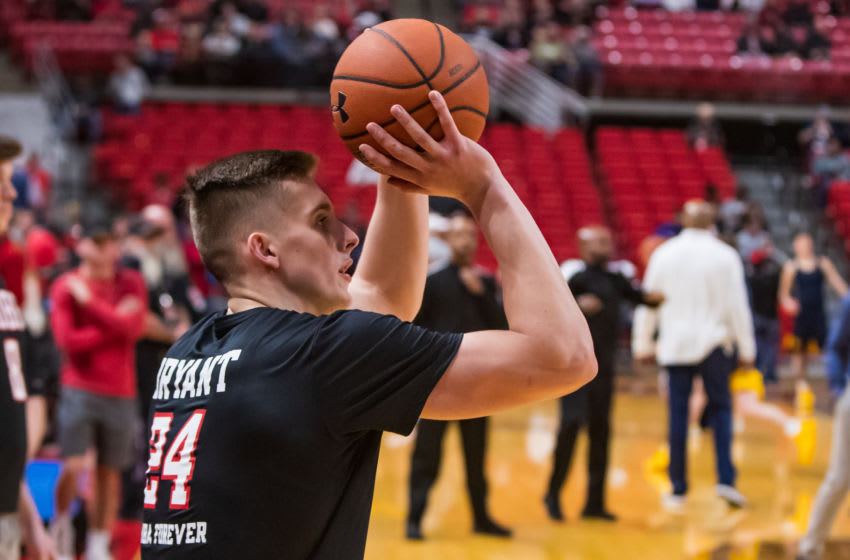 LUBBOCK, TEXAS - JANUARY 29: Forward Andrei Savrasov of the Texas Tech Red Raiders shoots the ball while wearing a shirt honoring the late Kobe Bryant during warmups before the college basketball game against the West Virginia Mountaineers on January 29, 2020 at United Supermarkets Arena in Lubbock, Texas. (Photo by John E. Moore III/Getty Images)