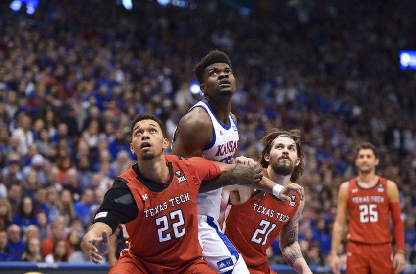 LAWRENCE, KANSAS - FEBUARY 1: Udoka Azubuike #35 of the Kansas Jayhawks battles for a rebound against TJ Holyfield #22 and Avery Benson #21 of the Texas Tech Red Raiders at Allen Fieldhouse on February 1, 2020 in Lawrence, Kansas. (Photo by Ed Zurga/Getty Images)