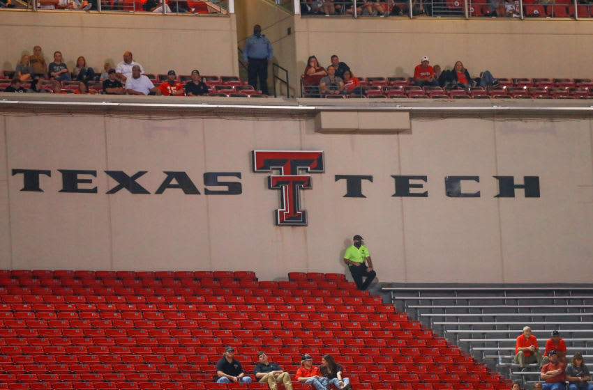 LUBBOCK, TEXAS - SEPTEMBER 12: Fans occupy socially distant seats during the second half of the college football game between the Texas Tech Red Raiders and the Houston Baptist Huskies on September 12, 2020 at Jones AT&T Stadium in Lubbock, Texas. (Photo by John E. Moore III/Getty Images)