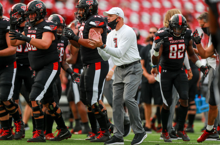 LUBBOCK, TEXAS - SEPTEMBER 12: Head coach Matt Wells of the Texas Tech Red Raiders looks on during warmups before the college football game against the Houston Baptist Huskies on September 12, 2020 at Jones AT&T Stadium in Lubbock, Texas. (Photo by John E. Moore III/Getty Images)
