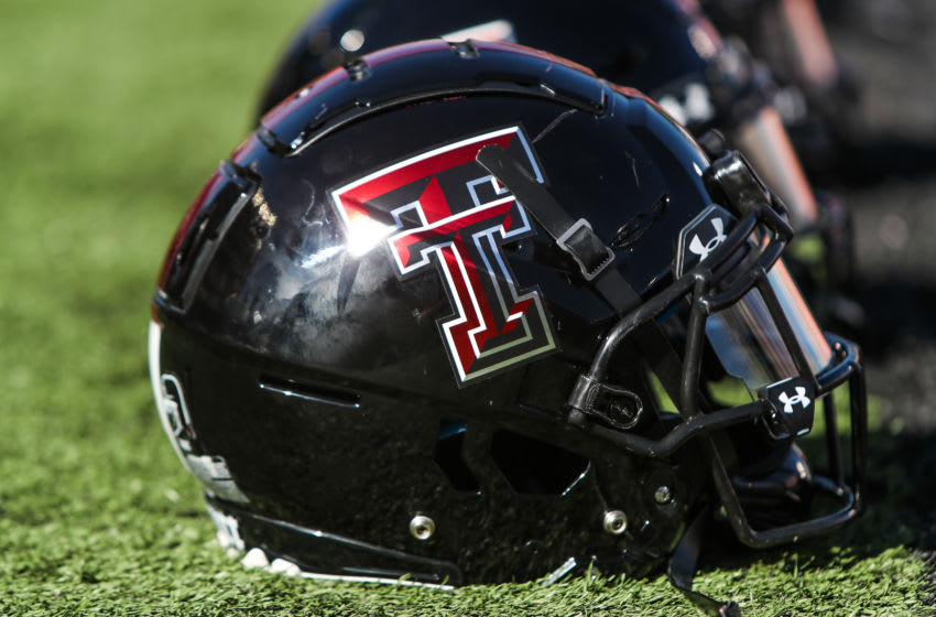 LUBBOCK, TEXAS - OCTOBER 24: Helmets sit along the sideline before the college football game between the Texas Tech Red Raiders and the West Virginia Mountaineers on October 24, 2020 at Jones AT&T Stadium in Lubbock, Texas. (Photo by John E. Moore III/Getty Images)