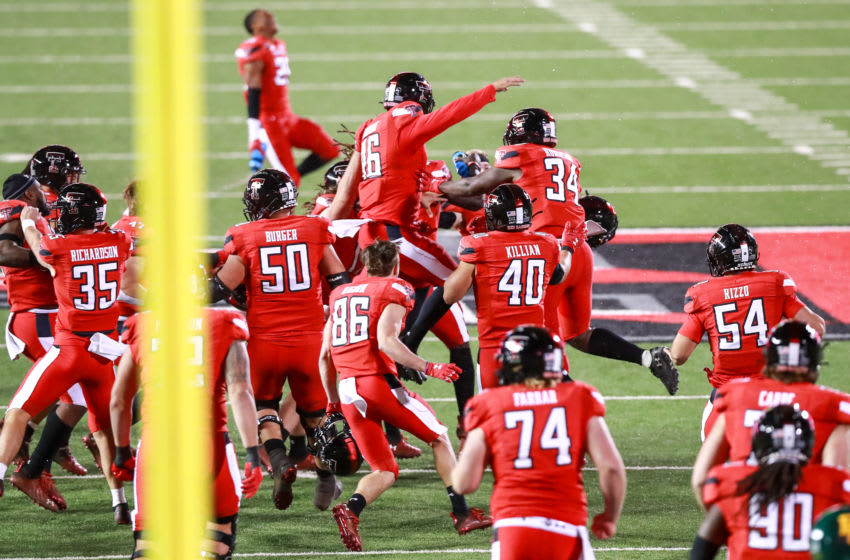 LUBBOCK, TEXAS - NOVEMBER 14: The Texas Tech Red Raiders celebrate on the field after the game winning field goal by kicker Jonathan Garibay #46 after the college football game against the Baylor Bears at Jones AT&T Stadium on November 14, 2020 in Lubbock, Texas. (Photo by John E. Moore III/Getty Images)