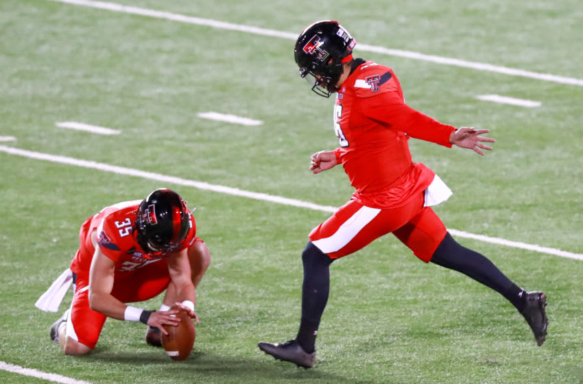LUBBOCK, TEXAS - NOVEMBER 14: Kicker Jonathan Garibay #46 of the Texas Tech Red Raiders kicks a field goal, held by Mark Richardson #35 during the second half of the college football game against the Baylor Bears at Jones AT&T Stadium on November 14, 2020 in Lubbock, Texas. (Photo by John E. Moore III/Getty Images)