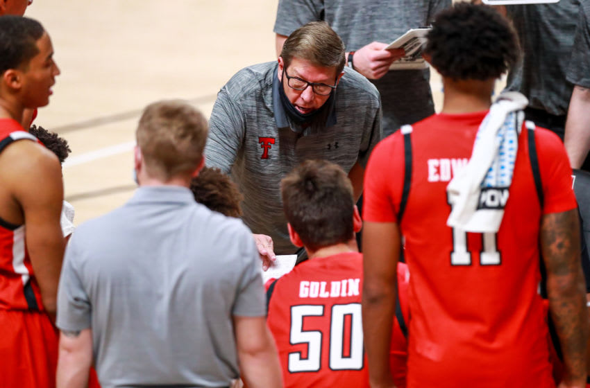 LUBBOCK, TEXAS - DECEMBER 06: Associate head coach Mark Adams of the Texas Tech Red Raiders addresses players during a timeout during the second half of the college basketball game against the Grambling State Tigers at United Supermarkets Arena on December 06, 2020 in Lubbock, Texas. (Photo by John E. Moore III/Getty Images)