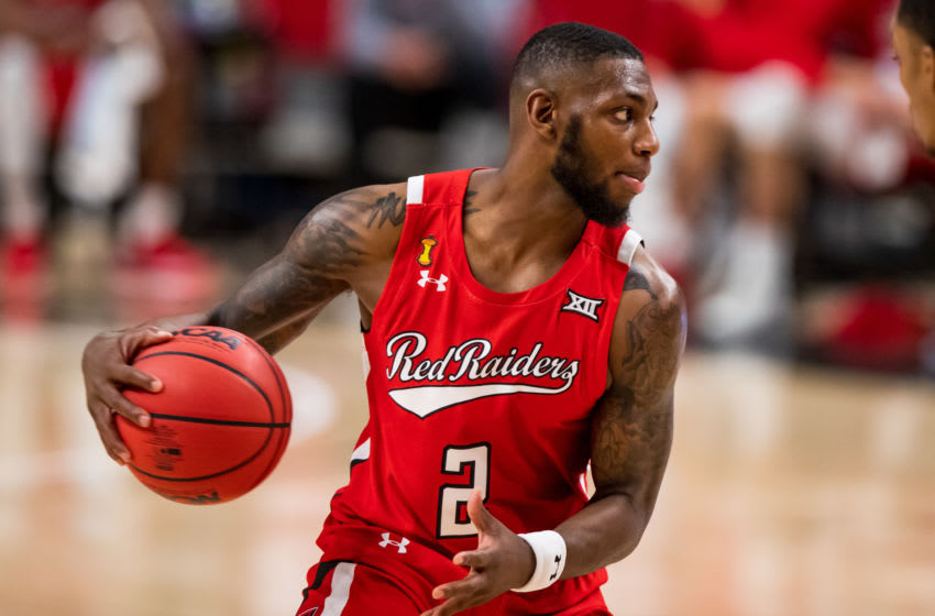 LUBBOCK, TEXAS - DECEMBER 06: Guard Jamarius Burton #2 of the Texas Tech Red Raiders handles the ball during the first half of the college basketball game against the Grambling State Tigers at United Supermarkets Arena on December 06, 2020 in Lubbock, Texas. (Photo by John E. Moore III/Getty Images)