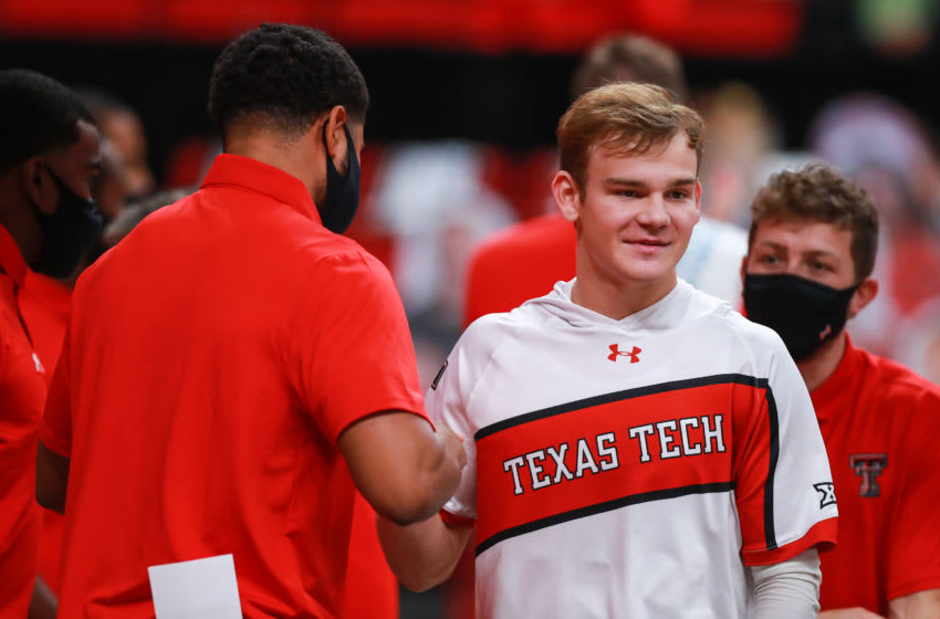 LUBBOCK, TEXAS - DECEMBER 29: Guard Mac McClung #0 of the Texas Tech Red Raiders greets coaches before the college basketball game against the Incarnate Word Cardinals at United Supermarkets Arena on December 29, 2020 in Lubbock, Texas. (Photo by John E. Moore III/Getty Images)