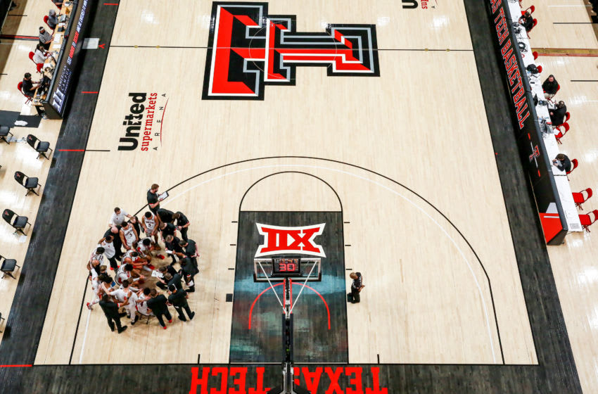 LUBBOCK, TEXAS - MARCH 04: The Texas Tech Red Raiders huddle during a timeout during the first half of the college basketball game against the Iowa State Cyclones at United Supermarkets Arena on March 04, 2021 in Lubbock, Texas. (Photo by John E. Moore III/Getty Images)