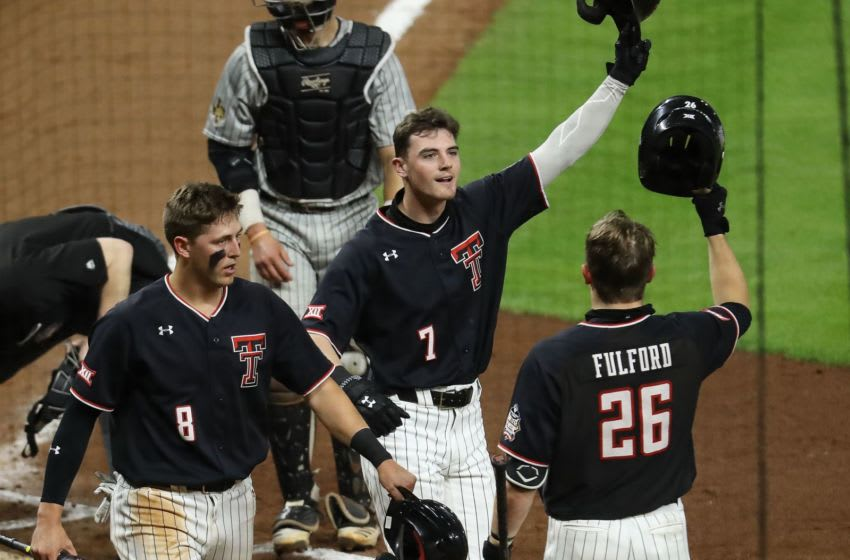 HOUSTON, TEXAS - MARCH 05: Cody Masters #7 of the Texas Tech Red Raiders is congratulated by Braxton Fulford #26 after hitting a home run against the Texas State Bobcats at Minute Maid Park on March 05, 2021 in Houston, Texas. (Photo by Bob Levey/Getty Images)