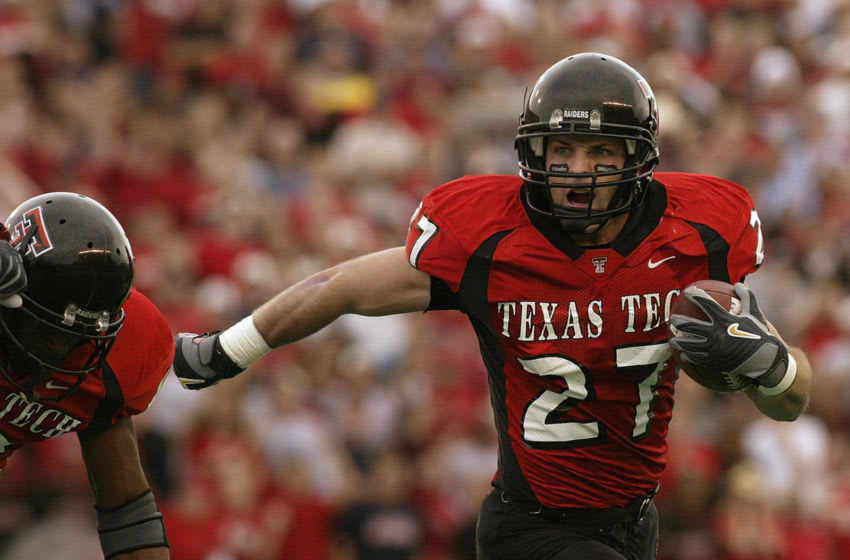 LUBBOCK, TX -NOVEMBER 22: Wide receiver Wes Welker #27 of the Texas Tech Red Raiders carries the ball during the game against the Oklahoma Sooners at Jones SBC Stadium on November 22, 2003 in Lubbock, Texas. The Sooners won 56-25. (Photo by Ronald Martinez/Getty Images)
