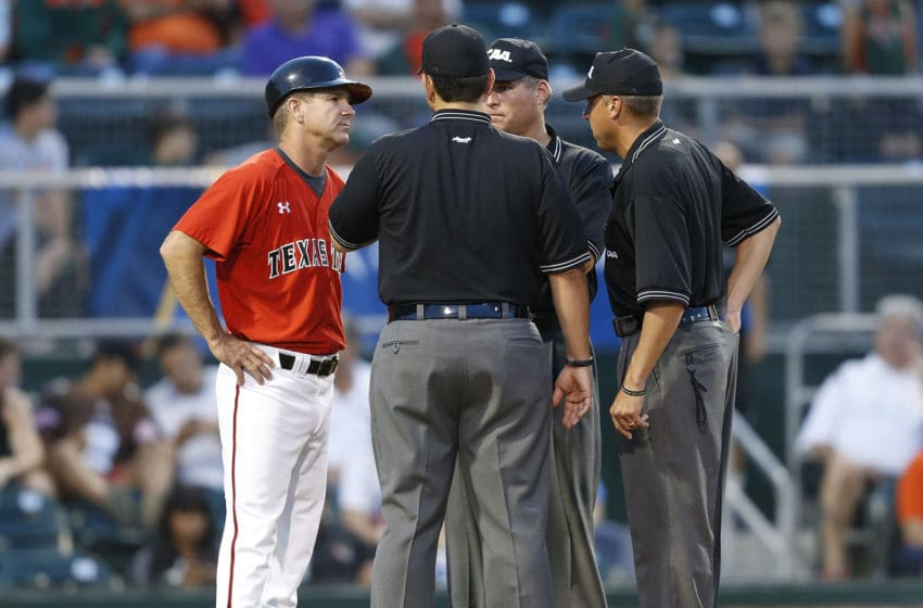 CORAL GABLES, FL - JUNE 1: Head coach Tim Tadlock #6 of the Texas Tech Red Raiders talks to the umpires after a bench clearing altercation with the Miami Hurricanes during the Coral Gables Regional at the NCAA Baseball Tournament on June 1, 2014 at Alex Rodriguez Park at Mark Light Field in Coral Gables, Florida. (Photo by Joel Auerbach/Getty Images)
