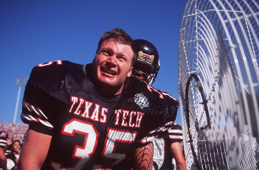 7 Oct 1995: Linebacker Zach Thomas of Texas Tech cools off near a fan during the Red Raiders 14-7 win over Texas A&M at Jones Stadium in Lubbock, Texas. Mandatory Credit: Al Bello/ALLSPORT