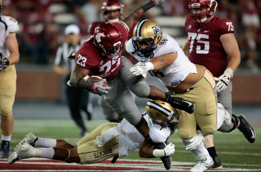 PULLMAN, WA - SEPTEMBER 02: Gerard Wicks #23 of the Washington State Cougars is tackled by Kelu Leota #98 of the Montana State Bobcats in the second half at Martin Stadium on September 2, 2017 in Pullman, Washington. Washington State defeated Montana State 31-0. (Photo by William Mancebo/Getty Images)