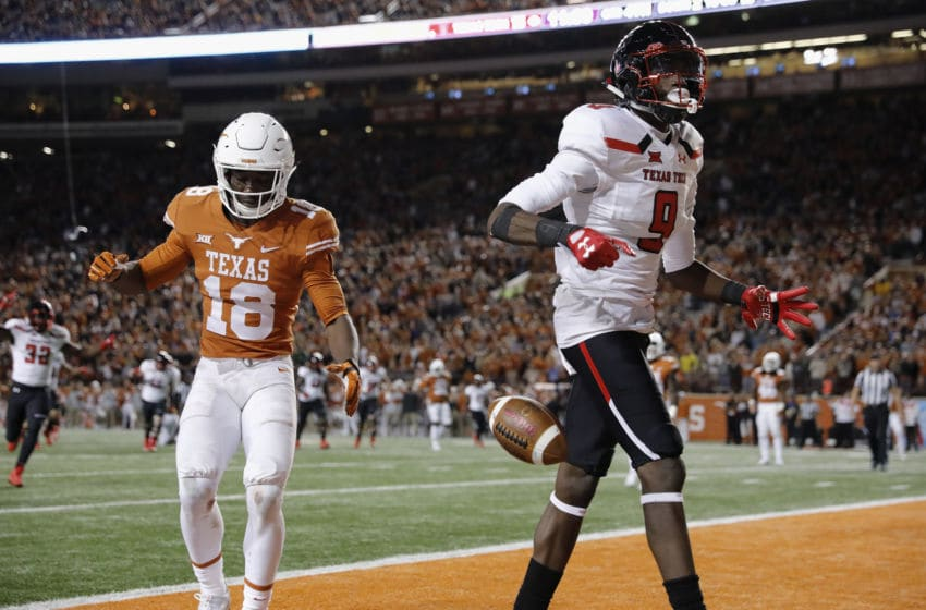 AUSTIN, TX - NOVEMBER 24: T.J. Vasher #9 of the Texas Tech Red Raiders catches a pass for a touchdown defended by Davante Davis #18 of the Texas Longhorns in the fourth quarter at Darrell K Royal-Texas Memorial Stadium on November 24, 2017 in Austin, Texas. (Photo by Tim Warner/Getty Images)