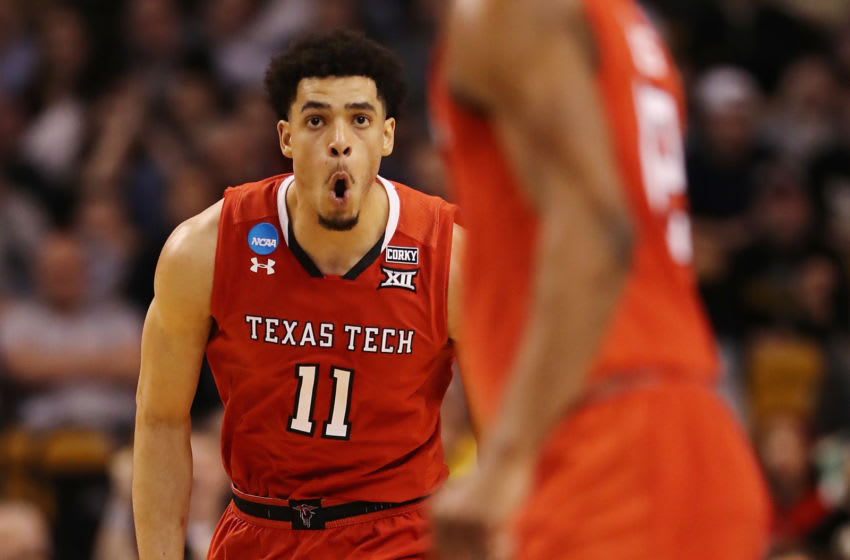 BOSTON, MA - MARCH 23: Zach Smith #11 of the Texas Tech Red Raiders celebrates during the second half against the Purdue Boilermakers in the 2018 NCAA Men's Basketball Tournament East Regional at TD Garden on March 23, 2018 in Boston, Massachusetts. (Photo by Elsa/Getty Images)