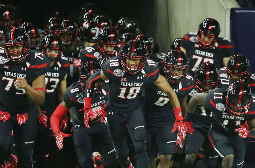 HOUSTON, TX - DECEMBER 29: Members of the Texas Tech Red Raiders take the field on the field before the start of their game against the LSU Tigers during the AdvoCare V100 Texas Bowl at NRG Stadium on December 29, 2015 in Houston, Texas. (Photo by Scott Halleran/Getty Images)