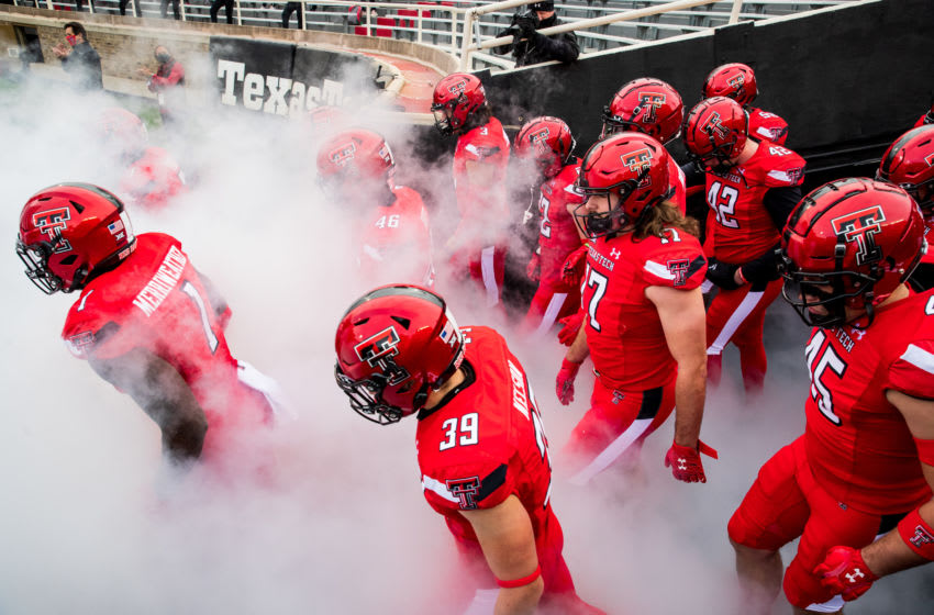 LUBBOCK, TEXAS - DECEMBER 05: Krishon Merriweather #1, Michael Nelson #39, Colin Schooler #17 and Christian LaValle #45 of the Texas Tech Red Raiders take the field before the college football game against the Kansas Jayhawks at Jones AT&T Stadium on December 05, 2020 in Lubbock, Texas. (Photo by John E. Moore III/Getty Images)
