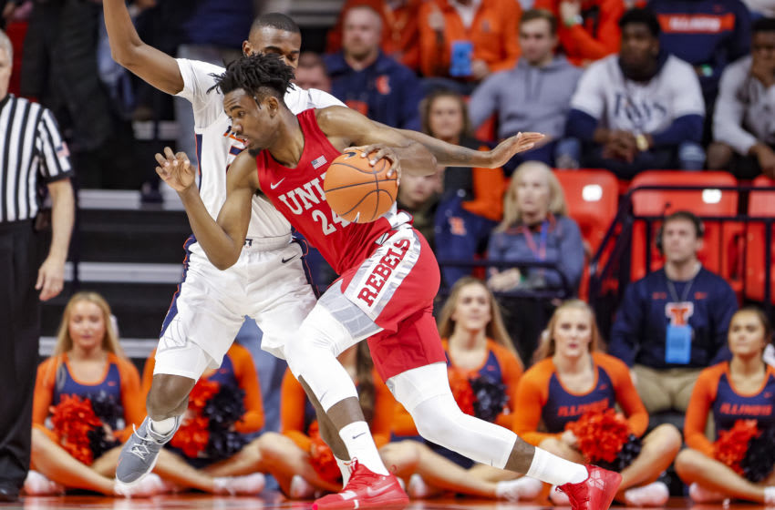 CHAMPAIGN, IL - DECEMBER 08: Joel Ntambwe #24 of the UNLV Rebels drives to the basket against Aaron Jordan #23 of the Illinois Fighting Illini at State Farm Center on December 8, 2018 in Champaign, Illinois. (Photo by Michael Hickey/Getty Images)
